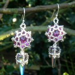 Swarovski rivolis trapped in filigree beadwork like tiny stained glass windows, with delicately beaded Czech spikes suspended below. These Tatiana Earrings are worked by modifying some components of the St Olave necklace.
